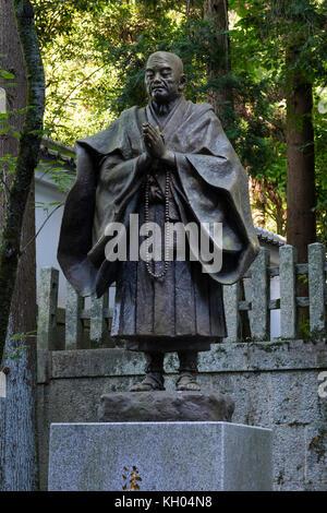 Kyoto, Japan - May 18, 2017: Statue of a praying buddhist monk - Stock Photo