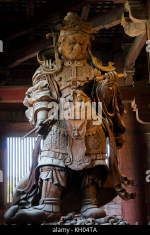 Nara, Japan -  May 29, 2017: Wooden statue of  Komokuten guardian watching over Todaiji Temple and its precincts - Stock Photo