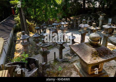 Nara - Japan, May 29, 2017: Many stone lanterns that lead up to the Kasuga Taisha shrine - Stock Photo