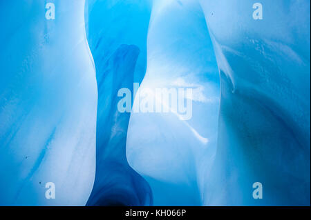 Very bluie ice in an Ice cave in the Fox Glacier, South Island, New Zealand - Stock Photo