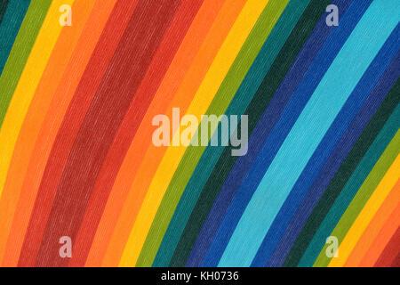 canvas of a beach umbrella having the colors of the rainbow - Stock Photo