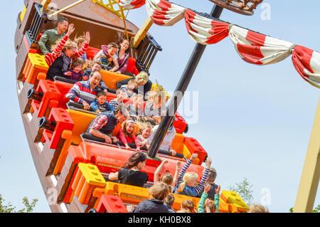 WINDSOR, BERKSHIRE. ENGLAND UK- APRIL 20 2016 : Legoland resort. People enjoying one of the many rides at Legoland - Stock Photo
