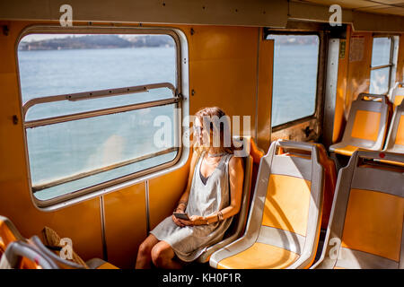 Woman traveling in ferry - Stock Photo