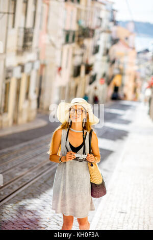 Woman traveling in Lisbon, Portugal - Stock Photo