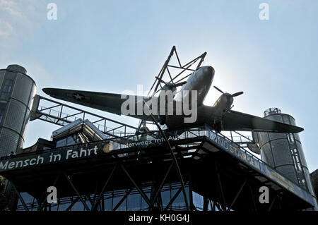 Dakota plane on the roof of Deutsches Technikmuseum, Trebbiner Straße, Berlin, Germany - Stock Photo