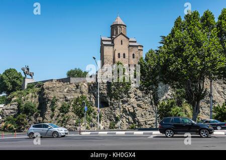 Tbilisi, Georgia, Eastern Europe - Metekhi Church and statue of King Vakhtang Gorgasali by the Mtkvari River. - Stock Photo