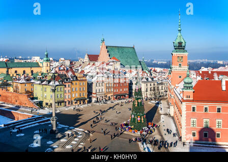 Warsaw old town in winter with Plac Zamkowy (Castle Square), Christmas tree with gifts, Cathedral, Royal Castle, Sigismund's Column and walking people