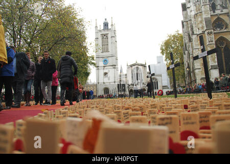 London, UK. 11th Nov, 2017. People seen walking into the Westminster Abbey compound, where thousands of crosses - Stock Photo