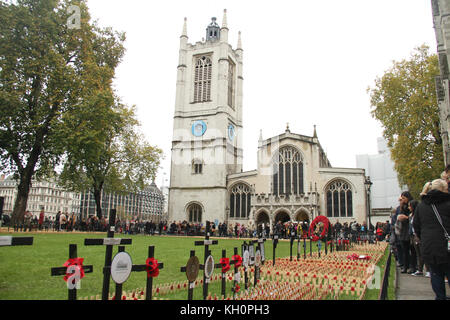London, UK. 11th Nov 2017. People seen walking below St Margaret's Church in the Westminster Abbey compound, where - Stock Photo