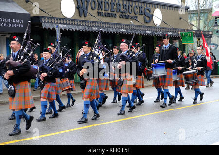 War veterans and supporters march down Commercial Drive near Grand View Park, for remembrance day November 11th, - Stock Photo
