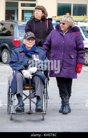 World War II decorated veteran on wheelchair at the Remembrance Day parade in London, Ontario, Canada. - Stock Photo