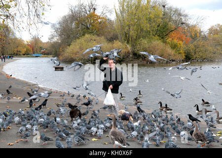 London UK 12 November 2017 Cold and autumn remembrance day, Eric ,the regents park bird-man ,feed the pigeons with - Stock Photo