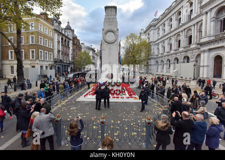 Whitehall, London, UK. 12th November 2017. Members of the public looking at the wreaths at the Cenotaph on Remembrance - Stock Photo