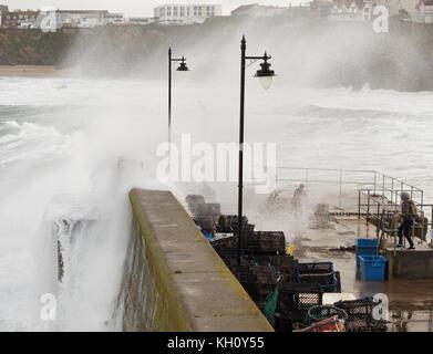 Newquay, UK. 12th Nov, 2017. UK weather Northerly rough seas pound Cornish coast drawing spectators and daredevils.12th, - Stock Photo