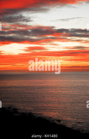 Lyme Bay, Dorset. 13th Nov, 2017. UK Weather. Sunset over Lyme Bay, seen from a clifftop garden on the Isle of Portland - Stock Photo