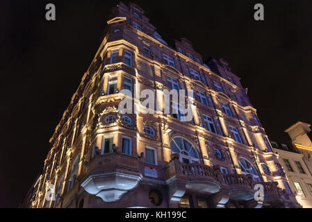 Beautiful buildings at Leicester Square in London at night - Stock Photo
