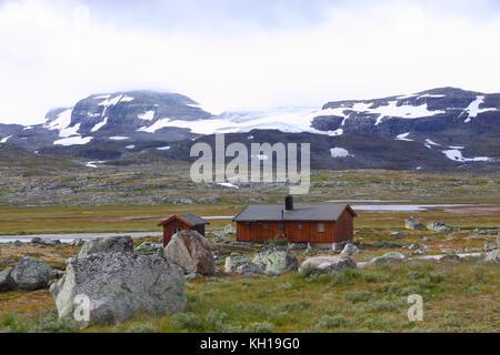 The edge of Hardangerjøkulen glacier visible from the Bergensbanen train just east of Finse, Norway. - Stock Photo