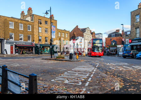 A 271 bus turns into its terminus in South Grove, Highgate Village, London, UK, on an autumn evening - Stock Photo
