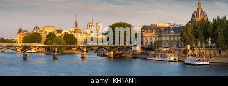 Panoramic view of the Seine River and Left Bank at Sunset with Ile de la Cite, Pont des Arts and the French Institute. - Stock Photo