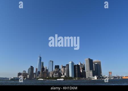 Lower Manhattan skyline taken from the Hudson River, onboard the Staten Island Ferry - Stock Photo