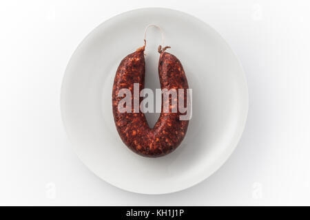 View of sausage on a white plate - Stock Photo