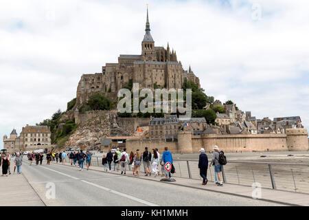 Mont Saint-Michel, Normandy, France - July 3, 2017: Tourists visiting island commune fortress Mont Saint-Michel - Stock Photo