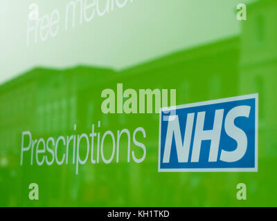 National Health Service prescriptions sign in pharmacy shop window - Stock Photo
