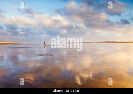 Sunset over Ninety Mile Beach, Northland, New Zealand. - Stock Photo