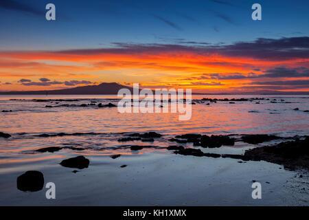 Rangitoto Island at sunrise, Auckland, New Zealand. - Stock Photo