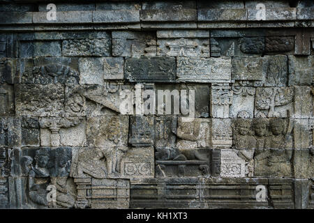 Carved relief at Borobudur on Java Indonesia. Borobudur is a Buddhist stupa and temple complex in Central Java and - Stock Photo