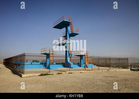 Kabul - Diving Boards and olympic-sized swimming pool built by the Russians in bid for Olymic Games. The pool was - Stock Photo