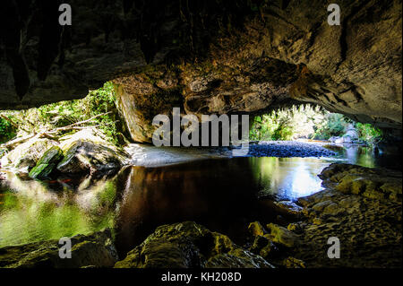 Moria gate arch in the Oparara Basin, Karamea, South Island, New Zealand - Stock Photo