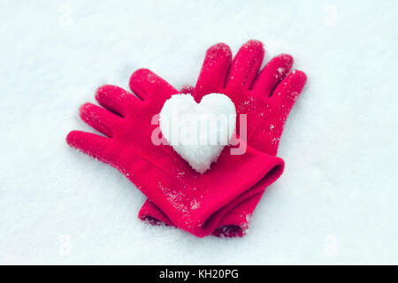 snow heart on red gloves. Winter holidays, Valentine's day, love symbol concept. Valentine's Day greeting card - Stock Photo