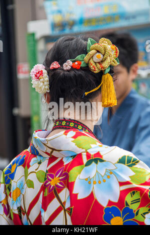 Unidentified woman in traditional clothes near Fushimi Inari shrine in Kyoto, Japan. - Stock Photo