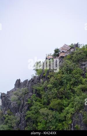 Hillside hut above the Nam Ou valley at Nong Khiaw, Laos - Stock Photo