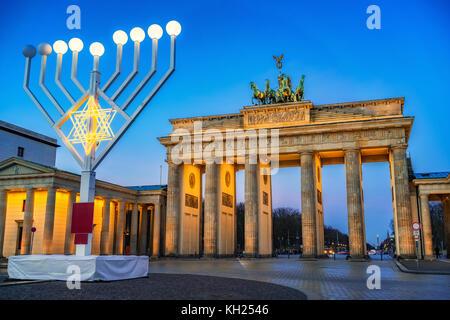 Brandenburg gate and hanukkah menorah - Stock Photo