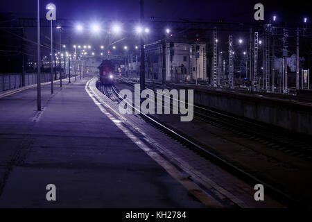 Lights on railway station. Night scene. Blue toned image - Stock Photo