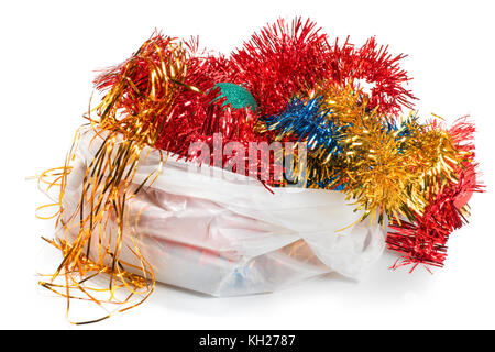 Christmas decorations in white plastic bag. Isolated on white - Stock Photo