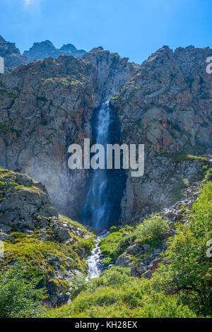 Waterfall in Ala Archa national park, Kyrgyzstan in summer - Stock Photo