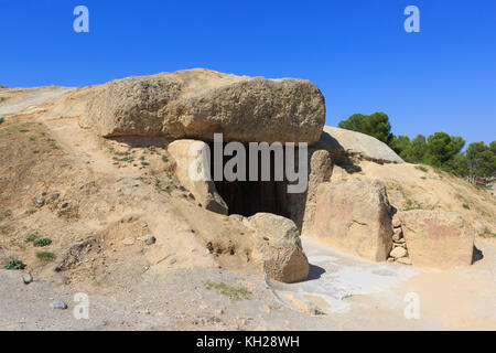 Entrance to the Dolmen of Menga (Dolmen de Menga), dating from the 3rd millennium BCE in Antequera, Spain - Stock Photo