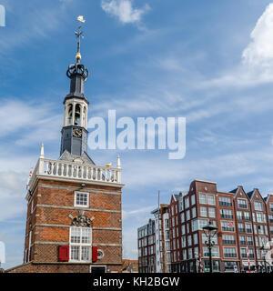 ALKMAAR, THE NETHERLANDS - APRIL 22, 2016: View of Accijnstoren tower, built in 1622 in the harbor of Alkmaar, the - Stock Photo