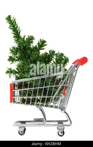Isolated objects: toy Christmas tree in a shopping cart, on white background, seasonal shopping concept - Stock Photo