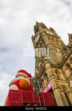 Giant Santa Claus above the Entrance to Manchester Town Hall, UK. Taken on 11 Nov 2017 on the first Saturday of - Stock Photo