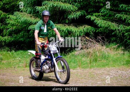 Motocross bike rider on a cross trail - Stock Photo