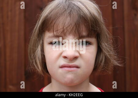 Portrait of an angry little girl - Stock Photo