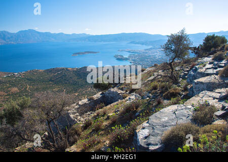 Panoramic view of the gulf of Mirambello with Spinalonga island. View from the mountain of Oxa with ruins of ancient - Stock Photo
