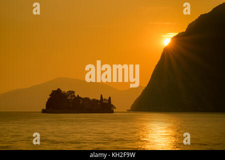San Paolo island on Iseo Lake in sunset, Italy - Stock Photo
