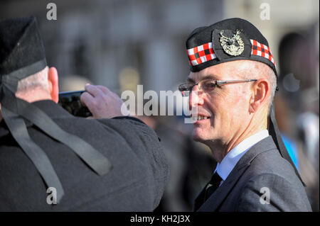 London, UK.  12 November 2017.  War veterans take a photo as large crowds gather around Parliament Square and Whitehall - Stock Photo