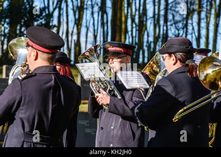 Members of the Salvation Army brass band play in front of a gathering for the remembrance Sunday service of reconciliation - Stock Photo