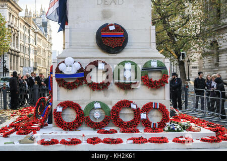 London UK. 12th November 2017. Police officers guard the cenotaph with newly laid wreaths by members of the Royal - Stock Photo
